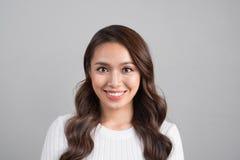 Close up portrait of smiling confident businesswoman looking str Stock Image