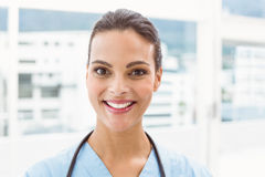 Close up portrait of a smiling confident female doctor Royalty Free Stock Photos