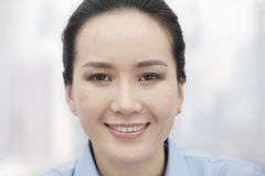 Close-up portrait of smiling confident young woman looking at camera Royalty Free Stock Photos