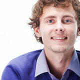 Close-up portrait of a smiling curly man. Close-up portrait of a smiling man with healthy teeth Royalty Free Stock Image