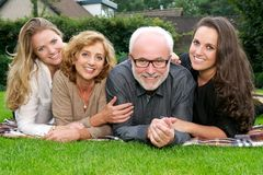 Close up portrait of a smiling family outdoors Royalty Free Stock Image