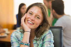 Close up portrait of a smiling female at  coffee shop Royalty Free Stock Image