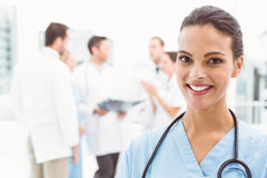 Close up portrait of smiling female doctor. Close up portrait of a smiling confident female doctor at medical office Royalty Free Stock Photography