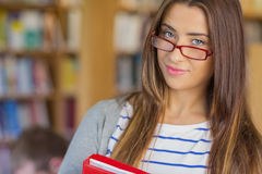 Close up portrait of a smiling female student in library Stock Photography