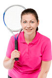 Close-up portrait of a smiling girl with a tennis racket royalty free stock photos