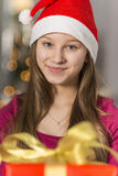 Close-up portrait of smiling girl wearing Santa hat Royalty Free Stock Photography