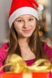 Close-up portrait of smiling girl wearing Santa hat Stock Photos