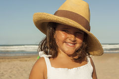Close up portrait smiling girl wearing wicker hat in summer. Beach background. stock photos