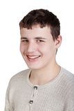 Close-up portrait of smiling half-turned teen boy Stock Images