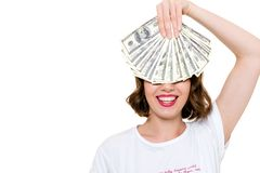 Close up portrait of a smiling happy girl. Holding bunch of money banknotes at her face and laughing isolated over white background Royalty Free Stock Photos