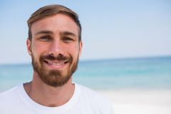 Close up of portrait of smiling man beach. Close up of portrait of smiling man standing at beach Stock Photo