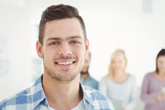 Close-up portrait of smiling man. Close-up portrait of smiling men standing at office Stock Image