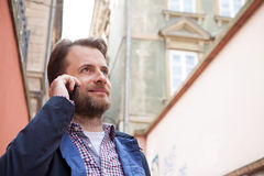 Close up portrait of smiling man talking on a mobile phone Stock Photography