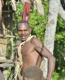Close up portrait of a smiling man from the tribe of Asmat Royalty Free Stock Image