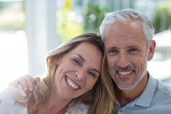 Close-up portrait of smiling mature couple. In restaurant Stock Photo