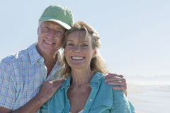 Close up portrait of smiling senior couple on sunny beach Royalty Free Stock Images