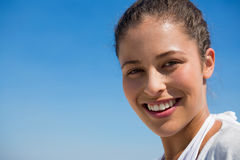 Close up portrait of smiling woman against blue sky Royalty Free Stock Photo