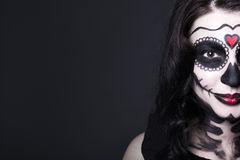 Close up portrait of smiling woman with Halloween skull make up Stock Photos