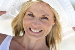 Close up portrait of smiling woman in sun hat Stock Photos