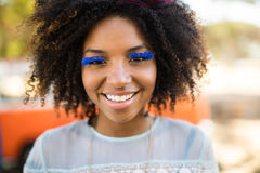 Close up portrait of smiling woman wearing artificial eyelashes Royalty Free Stock Images