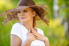 Close-up portrait of smiling woman wearing hat Royalty Free Stock Image