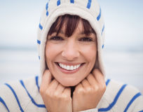 Close up portrait of smiling woman wearing hooded sweater Royalty Free Stock Image