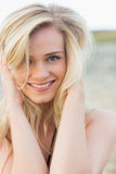Close up portrait of smiling young blond at beach Stock Images