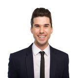 Close up portrait of a smiling young business man Royalty Free Stock Image