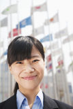 Close- up portrait of smiling young businesswoman Stock Photos