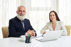 Close up of portrait of smiling young businesswoman and senior i Stock Photography