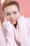 Close-up portrait of smiling young woman. In pink Stock Photo