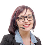 Close-up portrait of smiling young woman with headset Royalty Free Stock Images