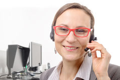 Close-up portrait of smiling young woman with headset Royalty Free Stock Image