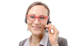 Close-up portrait of smiling young woman with headset Stock Photography
