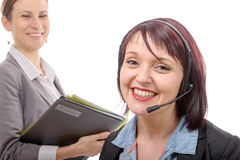 Close-up portrait of smiling young woman with headset Stock Images