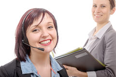 Close-up portrait of smiling young woman with headset Royalty Free Stock Photos
