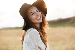 Close up portrait of a smiling young woman with long hair Stock Image
