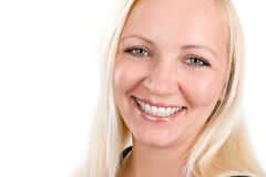 Close-up portrait of a smiling young woman. Over white royalty free stock photos