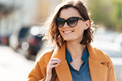 Close up portrait of a smiling young woman in sunglasses stock images