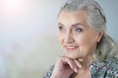 Close up portrait of beautiful senior woman. Close up portrait of smilling beautiful senior woman posing at home stock image