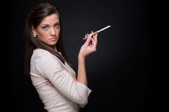 Close up portrait of smocking young fashion woman Stock Image