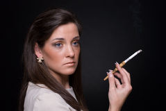 Close up portrait of smocking young fashion woman Stock Photo