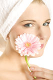 Close-up portrait of spa woman pink flower Stock Photos