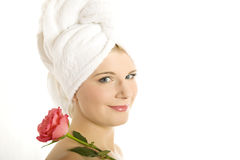 Close-up portrait of spa woman pink flower Royalty Free Stock Photos
