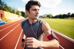 Close up portrait of a sports man running with earphones Stock Images
