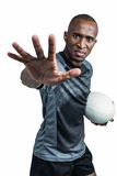 Close-up portrait of sportsman gesturing while standing with rugby ball Stock Photos