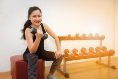 Close up portrait of sporty woman lifting dumbbells in gym, Spor. Close up portrait of sporty woman lifting dumbbells in gym., Sport and healthy concept Stock Image