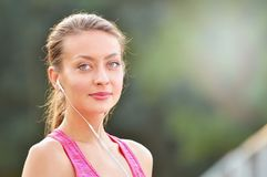 Close up portrait of fitness woman listening music Stock Image