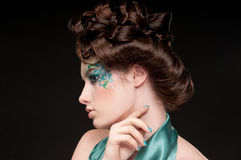 Close-up portrait of sprite girl with faceart Royalty Free Stock Images