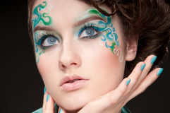Close-up portrait of sprite girl with faceart Stock Images